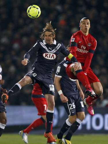 Paris Saint-Germain's Zlatan Ibrahimovic (R) jumps to head the ball against Bordeaux's Jaroslav Plasil (L) during their French Ligue 1 soccer match at the Chaban Delmas Stadium in Bordeaux, Southwestern France, January 20, 2013.