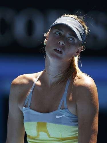 Sharapova shows frustration after losing her first two sets of the tournament... and her last two. REUTERS/Damir Sagolj