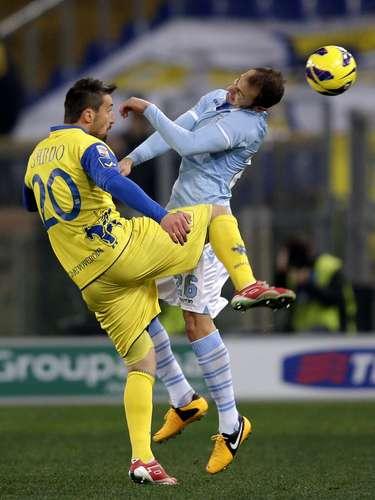 Lazio's Stefan Radu (R) challenges Chievo's Gennaro Sardo . REUTERS/Max Rossi