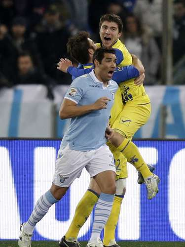 Paloschi (R) celebrates with teammates. REUTERS/Max Rossi