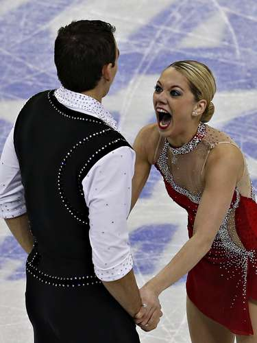 Alexa Scimeca reacts with partner Christopher Knierim following their routine during the pairs free skate at the U.S. Figure Skating Championships in Omaha, Nebraska, January 26, 2013.  REUTERS/Jim Young  (UNITED STATES - Tags: SPORT FIGURE SKATING)