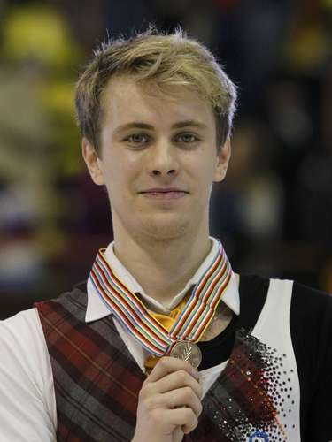 Bronze medallist Michal Brezina of Czech Republic poses during the award ceremony for the men's skating at the European Figure Skating Championships in Zagreb January 26, 2013.    REUTERS/Antonio Bronic (CROATIA  - Tags: SPORT FIGURE SKATING)