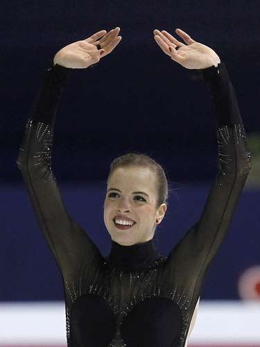 Carolina Kostner of Italy reacts after her performance during the women's free skating program at the European Figure Skating Championships in Zagreb January 26, 2013.     REUTERS/Antonio Bronic (CROATIA  - Tags: SPORT FIGURE SKATING)