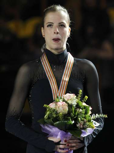 Gold medallist Carolina Kostner of Italy poses on podium during the award ceremony for the women's skating competition at the European Figure Skating Championships in Zagreb January 26, 2013.       REUTERS/Antonio Bronic (CROATIA  - Tags: SPORT FIGURE SKATING)