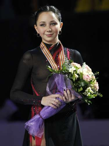 Bronze medallist Elizaveta Tuktamysheva of Russia poses on podium during the award ceremony for the women's skating competition at the European Figure Skating Championships in Zagreb January 26, 2013.        REUTERS/Antonio Bronic (CROATIA  - Tags: SPORT FIGURE SKATING)