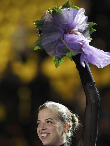 Gold medallist Carolina Kostner of Italy waves during the award ceremony for the women's skating competition at the European Figure Skating Championships in Zagreb January 26, 2013.         REUTERS/Antonio Bronic (CROATIA  - Tags: SPORT FIGURE SKATING)