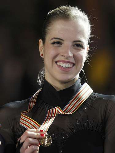 Gold medallist Carolina Kostner of Italy poses during the award ceremony for the women's skating competition at the European Figure Skating Championships in Zagreb January 26, 2013.        REUTERS/Antonio Bronic (CROATIA  - Tags: SPORT FIGURE SKATING)