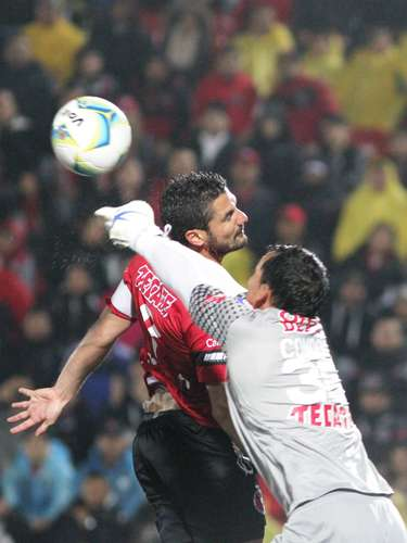 Under near constant rain and with wet conditions, the ball slips away from Pachuca's netminder.