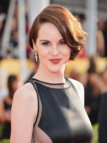 Downton Abbey actress Michelle Dockery shows a bit of side boob on the red carpet.