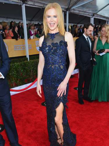 Nicole Kidman shows off a leg modestly.