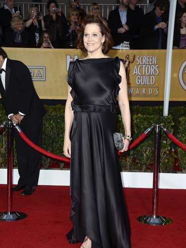 WORST. Sigourney Weaver has a great shape and all we get with this dress is a disaster! The whole top portion of the dress is a baggy understated mess.