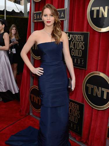 BEST. Jennifer Lawrence was radiant in this simple navy blue strapless Christian Dior dress which she paired with Chopard jewelry, a Roger Vivier bag and a pair of Jimmy Choos on her feet.