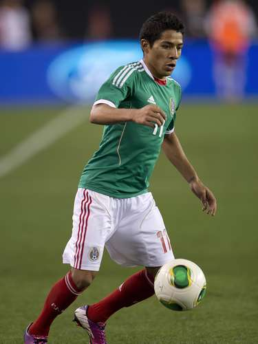 Javier Aquino runs with the ball.