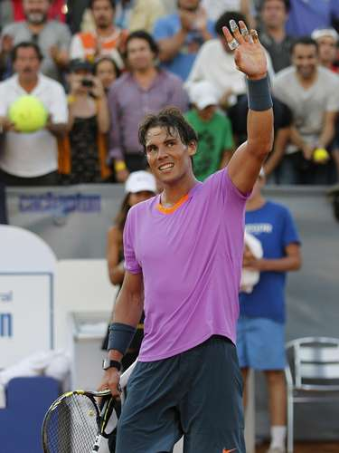 Spain's Rafael Nadal waves after winning his match against Argentina's Federico Delbonis during their men's singles match at the Chilean Open tennis tournament in Vina del Mar city February 6, 2013.