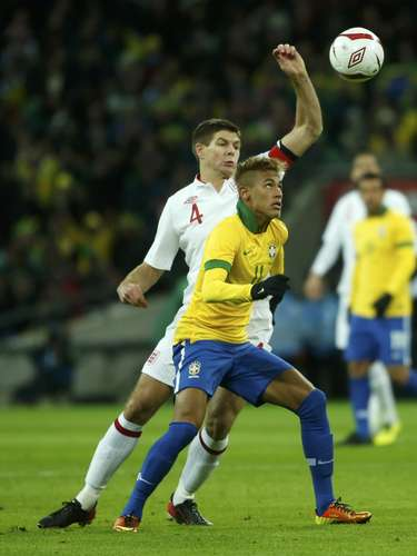 England's Steven Gerrard challenges Brazil's Neymar (R) during their international friendly soccer match.