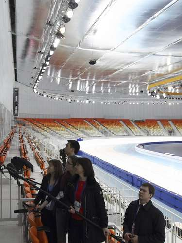 Russian President Vladimir Putin (L) talks to the media during his visit to the Speed Skating center Adler Arena, near the Black Sea resort of Sochi.
