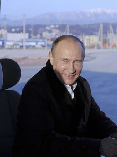 Russia's President Vladimir Putin (C) rides in a bus during a tour of Olympic venues.