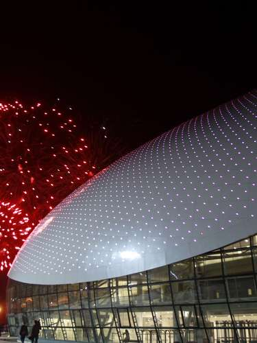 Fireworks explode near the Bolshoi Ice Dome following a ceremony to launch a countdown clock for the 2014 Winter Olympics.