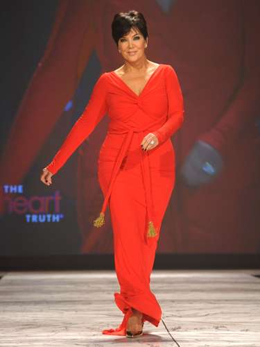 Kris Jenner who is about to hit her '60s proved that she could also bring a little sizzle to the event with an unusually fun walk down the catwalk with her tight red dress.