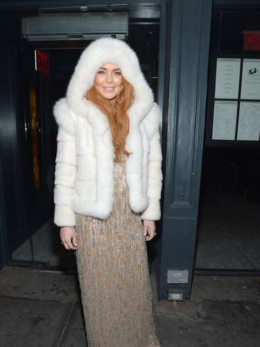 But La Lohan stepped out with a giant white fur coat outside of the amfAR Gala after party in celebration of Mercedes-Benz Fashion Week at SL on February 6, 2013 in New York City.