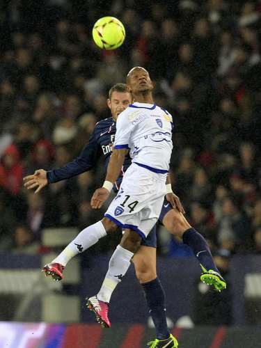 Bastia's Claudio Beauvue (front) challenges Paris Saint-Germain's Marco Verratti.