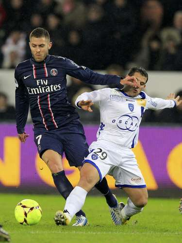 Paris Saint-Germain's Jeremy Menez (L) challenges Bastia's Gilles Cioni during their French Ligue 1 soccer match.
