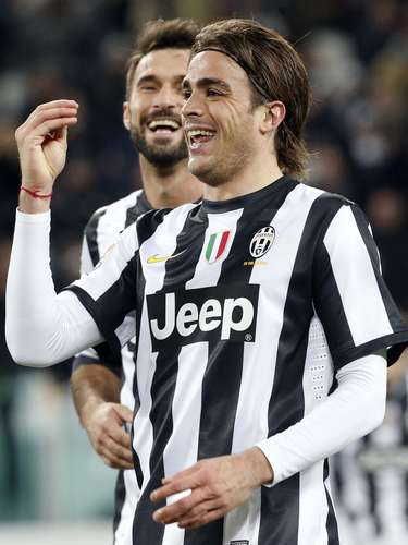 Juventus Alessandro Matri celebrates after scoring taking a boot off.