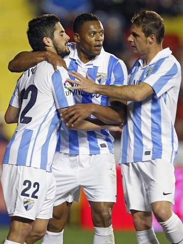 Isco, Baptista and Joaquín celebrate Isco's goal.