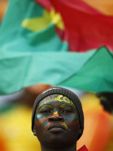 A Burkina Faso soccer fan waits for the start of the African Nations Cup.