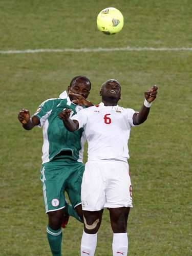 Burkina Faso's Djakaridja Kone challenges Nigeria's Sunday Mbah (L) during their African Nations Cup.