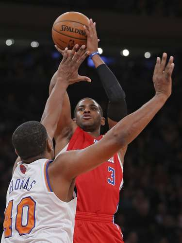 Los Angeles Clippers guard Chris Paul (3) shoots a three-point shot over New York Knicks forward Kurt Thomas (40) in the second quarter of their NBA basketball game at Madison Square Garden in New York, February 10, 2013.