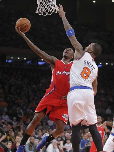 Los Angeles Clippers guard Jamal Crawford (11) drives against New York Knicks guard J.R. Smith (8) for a layup in the second quarter of their NBA basketball game at Madison Square Garden in New York, February 10, 2013.