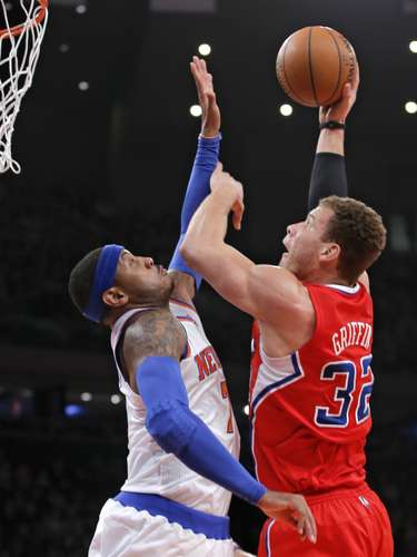 Los Angeles Clippers forward Blake Griffin (32) lays the ball up over New York Knicks forward Carmelo Anthony in the first quarter of their NBA basketball game at Madison Square Garden in New York, February 10, 2013.