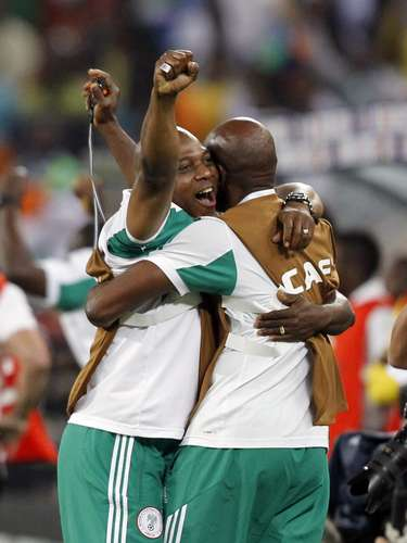 Nigeria's coach Stephen Keshi (L) celebrates after winning their African Nations Cup.