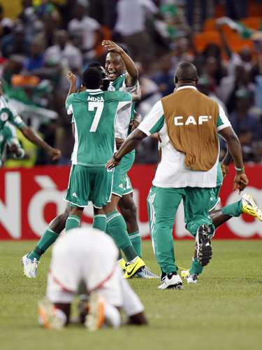 Nigeria's players celebrate after winning their African Nations Cup (AFCON 2013) final soccer match against Burkina Faso.