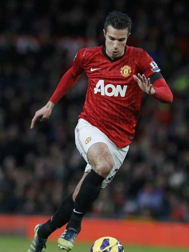 Manchester United's Robin van Persie controls the ball.