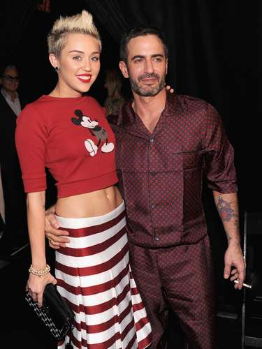Miley Cyrus paid homage to her Disney alma mater on Valentine's Day at Fashion Week in a red crop Mickey Mouse sweater that made the 20 year old entertainer look adorable with a hint of sexy baring her midriff. Check out more pics of Miles looking good at the Marc Jacobs fashion show in NYC