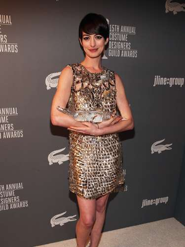 Anne Hathaway poses with the Lacoste Spotlight Award during the 15th Annual Costume Designers Guild Awards with presenting sponsor Lacoste at The Beverly Hilton Hotel on February 19, 2013 in Beverly Hills, California.