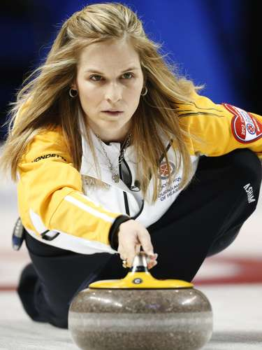 Manitoba skip Jennifer Jones throws a rock against Alberta during the ninth draw at Scotties Tournament of Hearts curling championship in Kingston, February 19, 2013.    REUTERS/Mark Blinch (CANADA - Tags: SPORT CURLING)