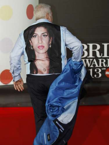 Mitch Winehouse, the father the late singer Amy Winehouse, takes off his jacket to display a picture of Amy on his waistcoat,  as he arrives for the BRIT Awards, celebrating British pop music, at the O2 Arena in London February 20, 2013. Last month eyebrows were raised when Amy Winehouse was nominated in the British female solo category some 18 months after her death for a chart-topping album of unreleased songs and demos called \