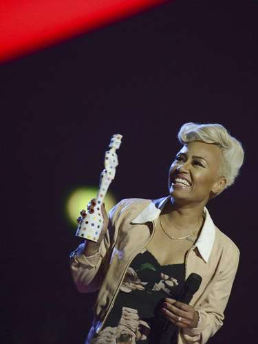 Singer Emeli Sande reacts after being awarded the best British Album award during the BRIT Awards, celebrating British pop music, at the O2 Arena in London February 20, 2013.    REUTERS/Dylan Martinez (BRITAIN  - Tags: ENTERTAINMENT SOCIETY) FOR EDITORIAL USE ONLY. NOT FOR SALE FOR MARKETING OR ADVERTISING CAMPAIGNS.