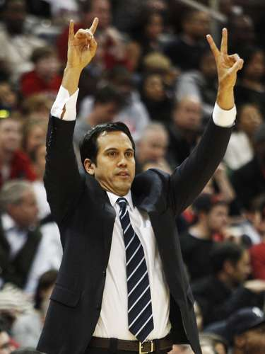 Miami Heat head coach Erik Spoelstra calls in a play during their game. REUTERS/Tami Chappell