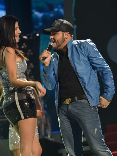Gerardo Ortiz chats up a pretty lady during his performance
