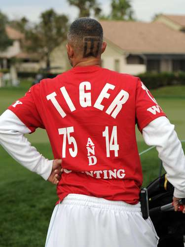 "A Tiger Woods fan with the letters ""TW"" shaved on the back of his head watches as Tiger Woods of the U.S. competes during the first round play in the Honda Classic PGA golf tournament in Palm Beach Gardens, Florida February 28, 2013."