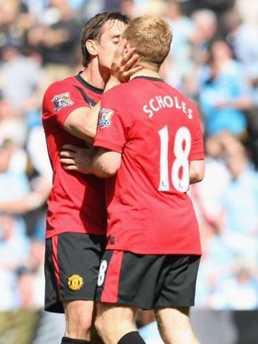 The immense goal of scoring a crucial goal got hold gold of Manchester United's Gary Nevile, who kissed Paul Scholes after scoring the game winner against Manchester City in 2010.