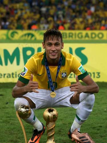 Neymar poses with the Confederations Cup trophy and the Golden Ball and the Bronze boot trophies