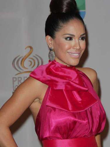 Television presenter Karla Martinez's skintone and her dress were a perfect match.