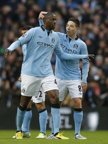 Manchester City's Yaya Toure (L) celebrates with Samir Nasri after scoring.