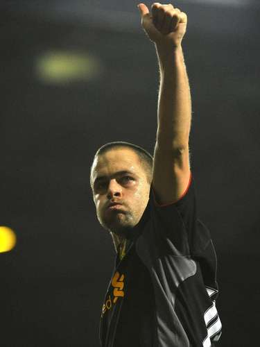 Liverpool's Joe Cole acknowledges fans following their English Premier League soccer match win against West Ham at Upton Park in London December 9, 2012.