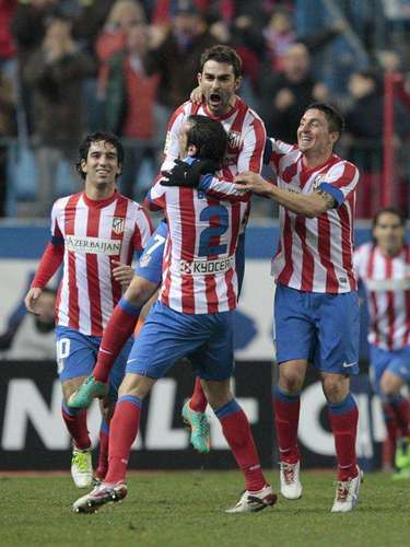 Atlético Madrid suffered, but edged Celta 1-0.